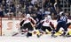 Apr 1, 2017; Winnipeg, Manitoba, CAN;  Winnipeg Jets center Mathieu Perreault (85) puts the puck past Ottawa Senators goalie Mike Condon (1) during the third period at MTS Centre. Winnipeg won 4-2. Mandatory Credit: Bruce Fedyck-USA TODAY Sports